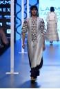 Payal Singhal Off The Runway Collection : BUSHRA STONE BRICK EMBROIDERED KURTA AND NAVY PALAZZO PANTS