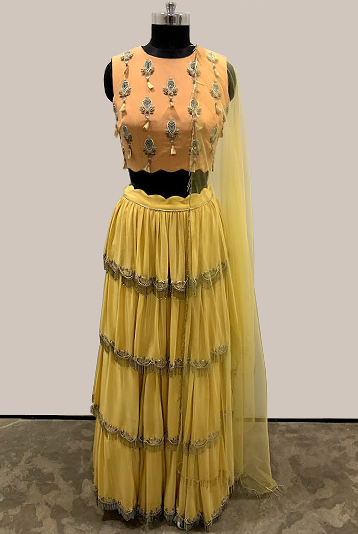 PS-FW522-D-1 Peach Crepe Choli with Pale Yellow Crepe Tiered Lehenga and Net Dupatta