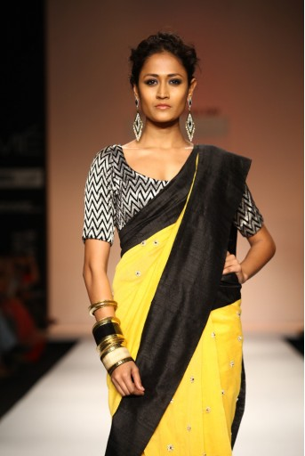 PS-FW184 Suraiya Sunset Yellow Silkmul Saree with Black Velvet Choli